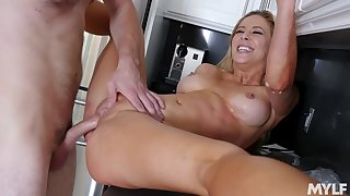 Blonde wife Cherie Deville not far from the perfect body fucked in the kitchen