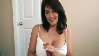 It is a delight to see this hot MILF massage my cock with her fat titties