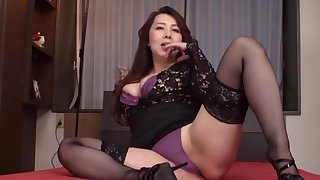 Clothed Japanese mature is ready to take down her undies