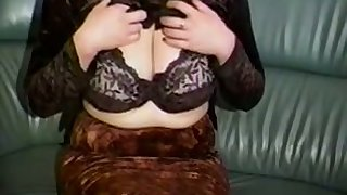 Horn-mad a bit buxom amateur cam MILF plays with her huge knockers